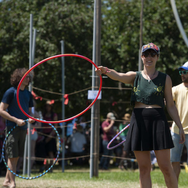 Person holding hoola hoop at arms length
