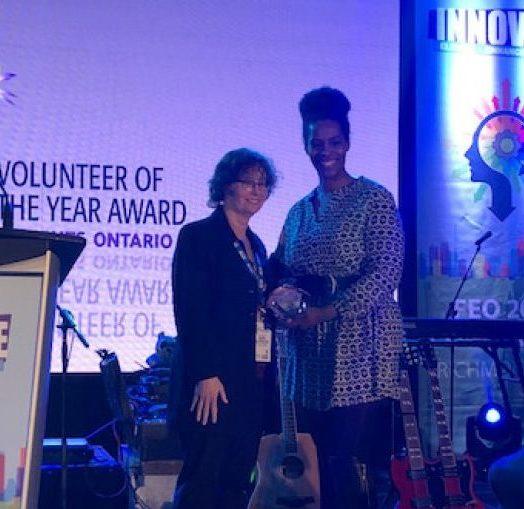 Seimone receiving volunteer award