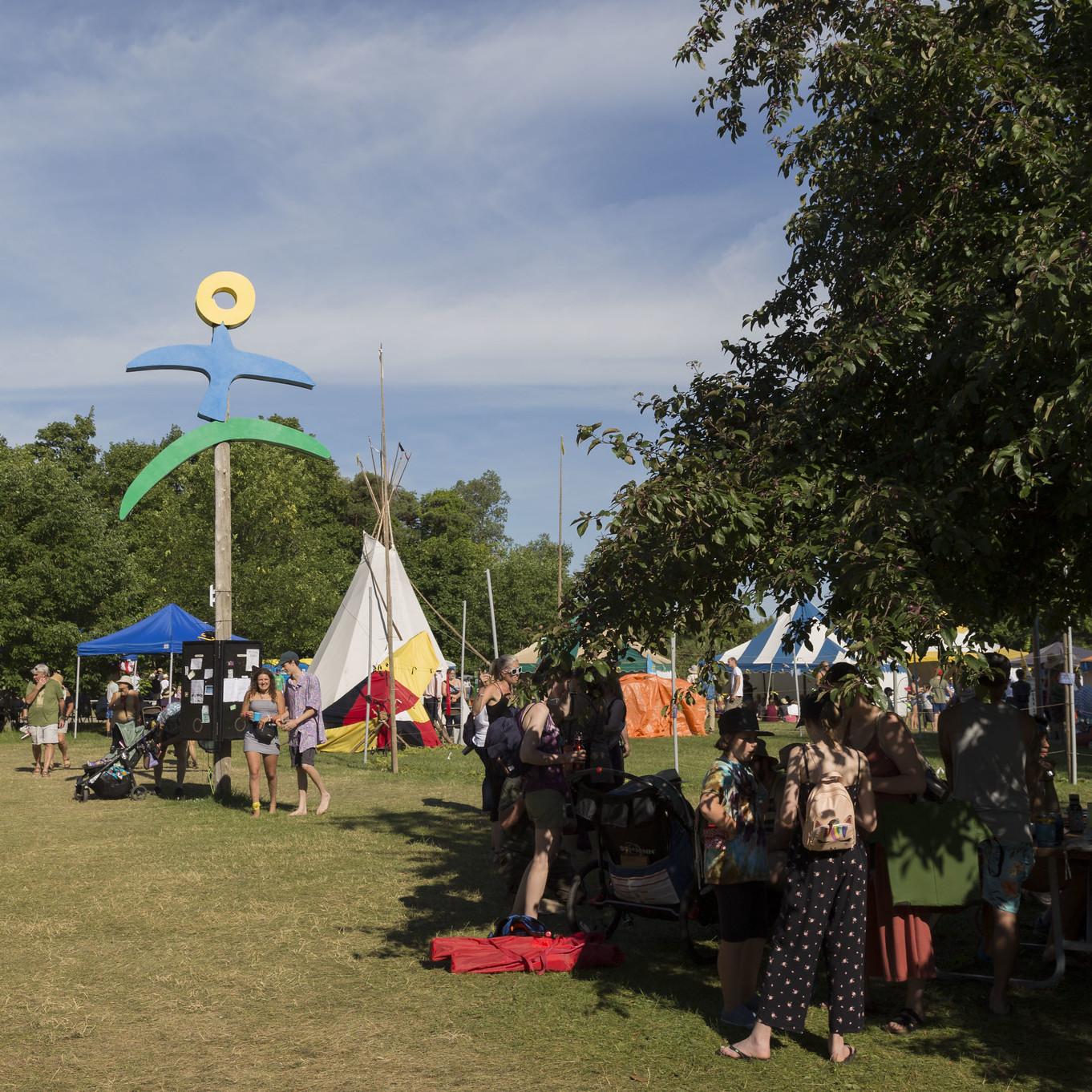 The large Hillside logo beside the tipi at the summer festival